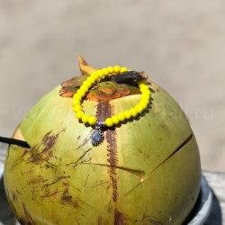 Браслет из хрустальных бусин ярко-желтый с подвеской солнце