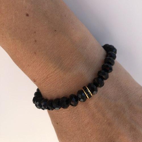 Браслет из кристаллов черный со вставкой сваровски золотого цвета
