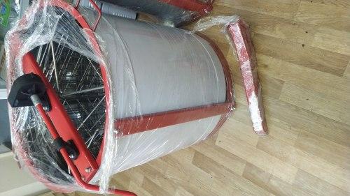 Медогонка 4-х рамочная оборотная полностью из нержавеющей стали
