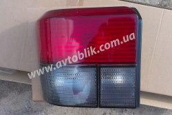 Задний фонарь левый на Volkswagen T4 (1990-2003) красно-дымчатый